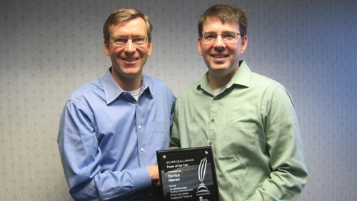 Indium Corporation Executive Vice President Ross Berntson (left) presents Derrick Herron, Technical Support Engineer with the 2015 Silver Quill Award.