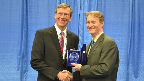Indium Corporation Executive Vice President Ross Berntson accepts CIRCUITS ASSEMBLY's NPI Award from Mike Buetow, editor in chief at CIRCUITS ASSEMBLY.