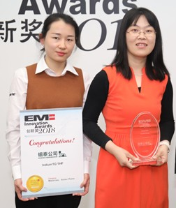 From left: Indium Corporation's Serena Zhu, Sales Admin Assistant, left, and Mary Ma, Research Chemist, right, accept the award.