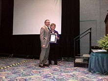 Indium Corporation President Greg Evans with JoAnn Stromberg, executive administrator of SMTA